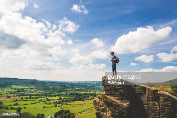 Teenage Boy Stands at Edge in Peak District