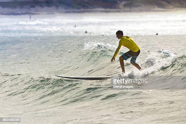 teenage boy surfing. - todos santos mexico fotografías e imágenes de stock