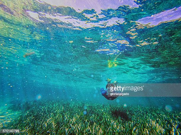 Teenage boy swimming with snorkel underwater, Rottnest, Australia