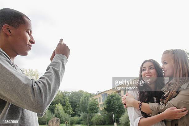 teenage boy taking pictures of friends - sigrid gombert stock pictures, royalty-free photos & images