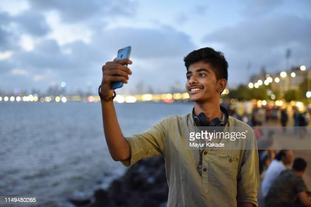 teenage boy taking selfie - india stock pictures, royalty-free photos & images