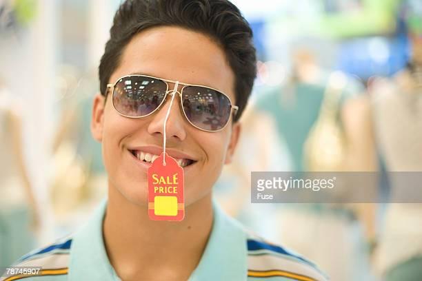 Teenage Boy Trying on Sunglasses