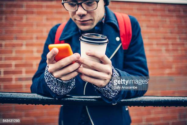 Teenage boy using a smart phone