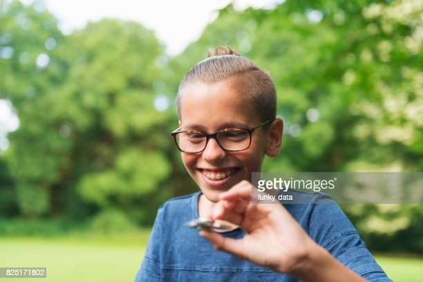 Teenage boy using fidget spinner