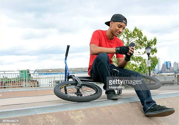 Teenage Boy using his Mobile