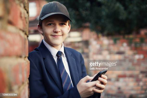 Teenage boy using smartphone