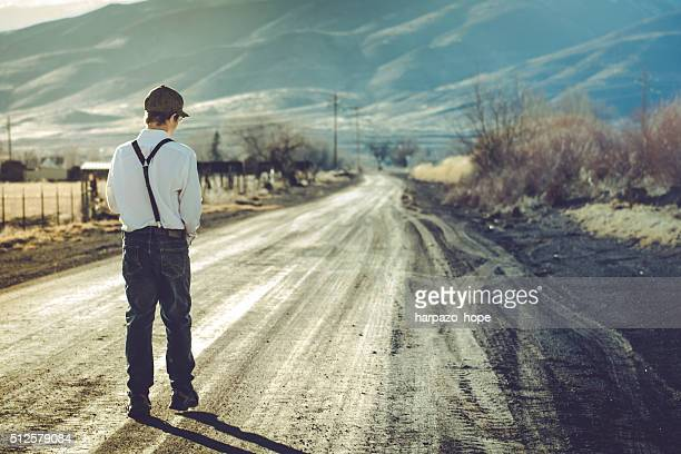 Teenage Boy Walking in a Rural Neighborhood