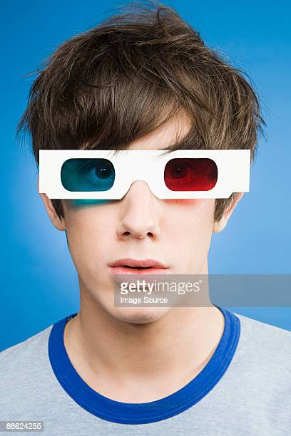 A teenage boy wearing 3d glasses