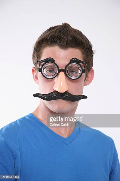 A Teenage Boy Wearing A Groucho Marx Mask; Troutdale Oregon United States Of America