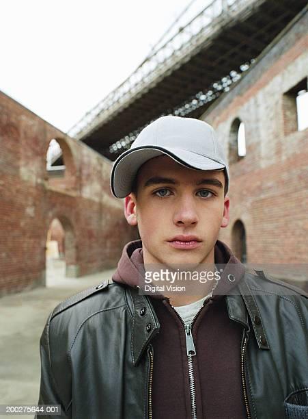 Teenage boy (15-17) wearing baseball cap, portrait