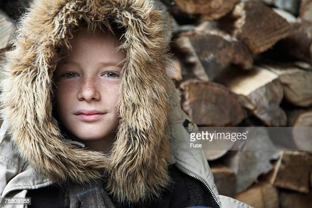 Teenage Boy Wearing Fur Hood