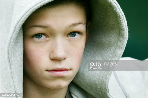 teenage boy (13-15) wearing hooded top, portrait, close-up - chav stock photos and pictures