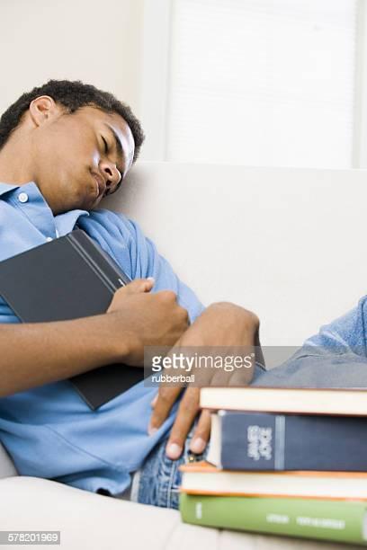 Teenage boy who fell asleep reading