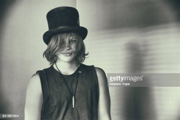 Teenage boy with a top hat.