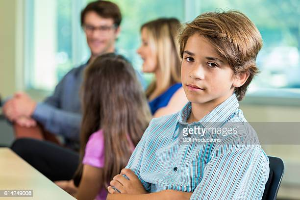 Teenage boy with attitude at parent teacher conference