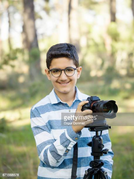 Teenage boy with camera
