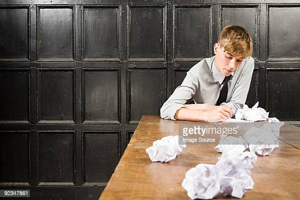 Teenage boy with crumpled paper