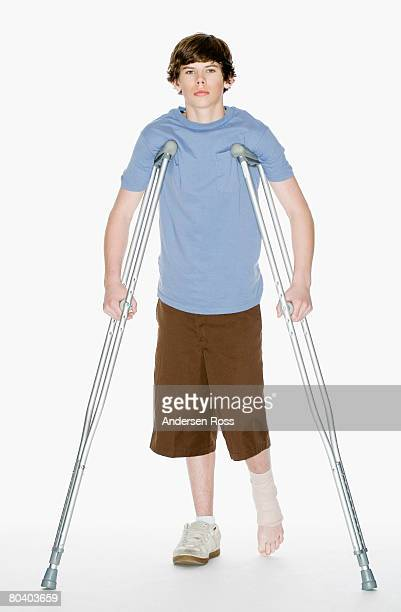 Teenage boy with crutches and foot injury