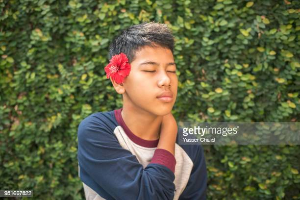 Teenage Boy with Flower on Ear