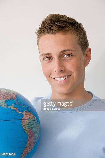 Teenage boy with globe