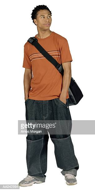 Teenage boy with hands in pocket
