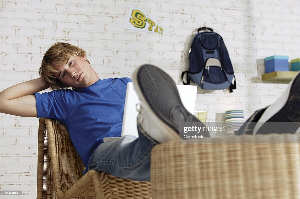 Teenage boy with laptop computer : Stock Photo