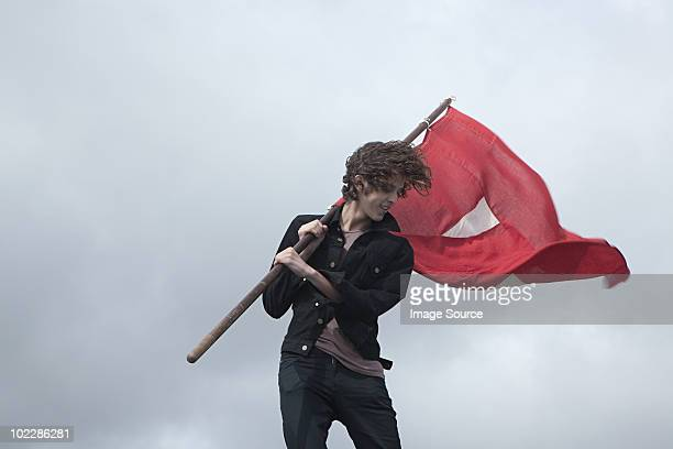 teenage boy with red flag - flag stock pictures, royalty-free photos & images