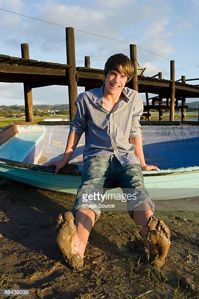 Teenage boy with rowboat