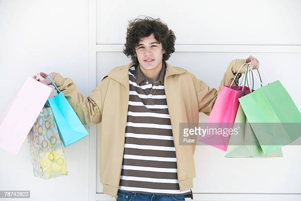 Teenage Boy with Shopping Bags