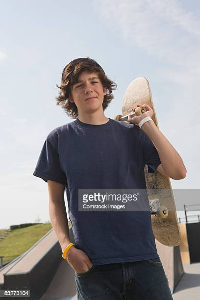 Teenage boy with skateboard