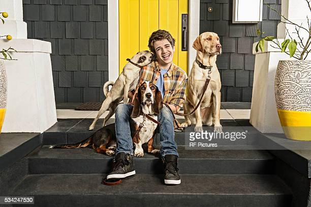teenage boy (13-15) with three dogs - three animals stock pictures, royalty-free photos & images