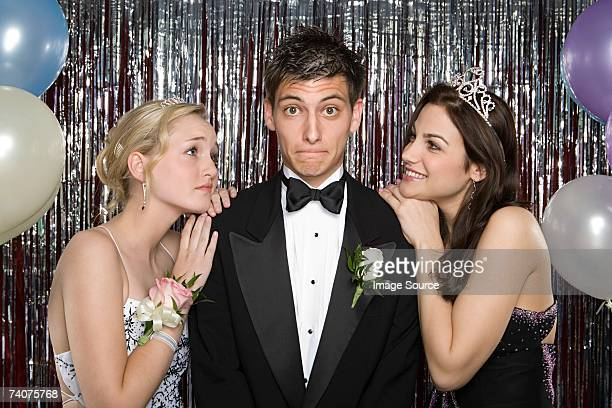 teenage boy with two girls at prom - prom stock pictures, royalty-free photos & images