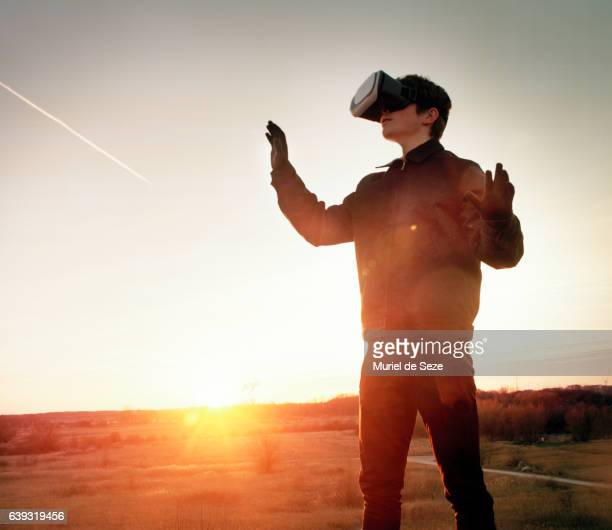 Teenage boy with Virtual Reality goggles