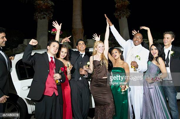 teenage boys and girls standing in front of a limousine dressed for their high school prom - prom stock pictures, royalty-free photos & images