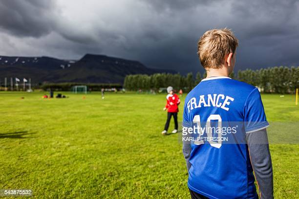Teenage boys attend a training on June 28 2016 at the the football club Afturelding in Mosfellsbaer outside of Reykjavik where national Iceland's...