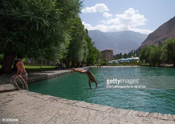 Teenage boys diving in the pool of Khorog city park GornoBadakhshan autonomous region Khorog Tajikistan on August 6 2016 in Khorog Tajikistan