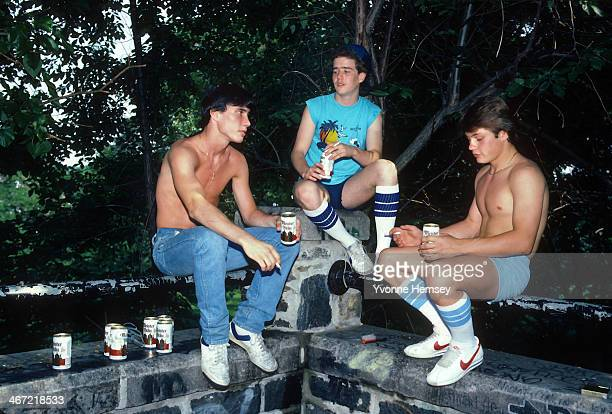 Teenage boys drinking beer on a hot summer day are photographed June 21 1984 in New York City
