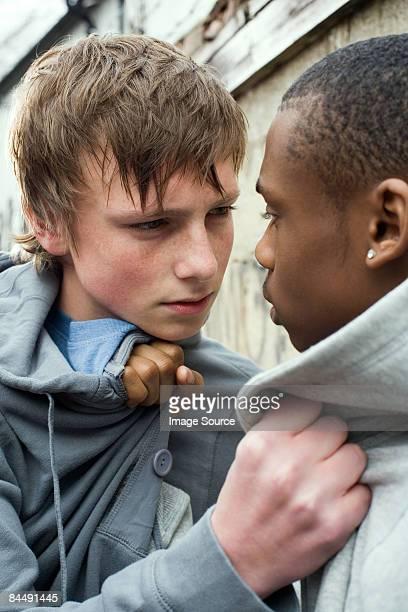 Teenage boys fighting