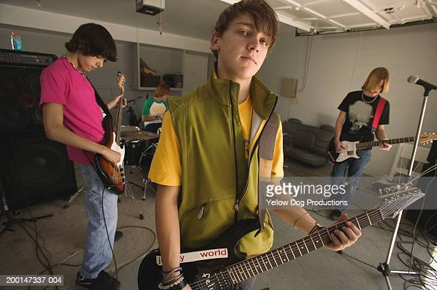 teenage boys (15-17) in band practicing in garage, portrait - teenagers only stock pictures, royalty-free photos & images