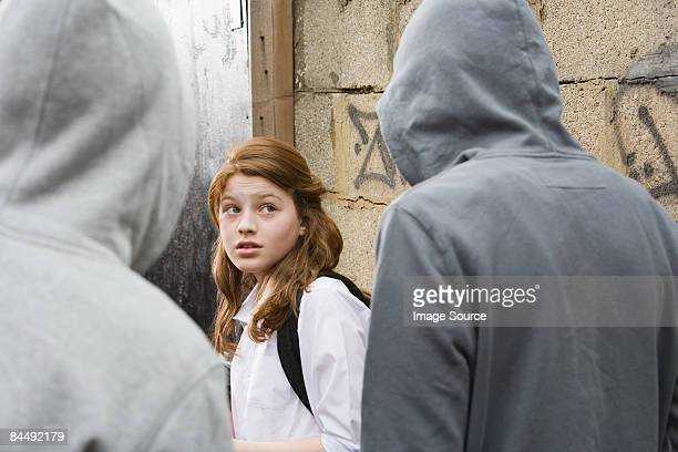 teenage boys intimidating a teenage girl - harassment stock photos and pictures