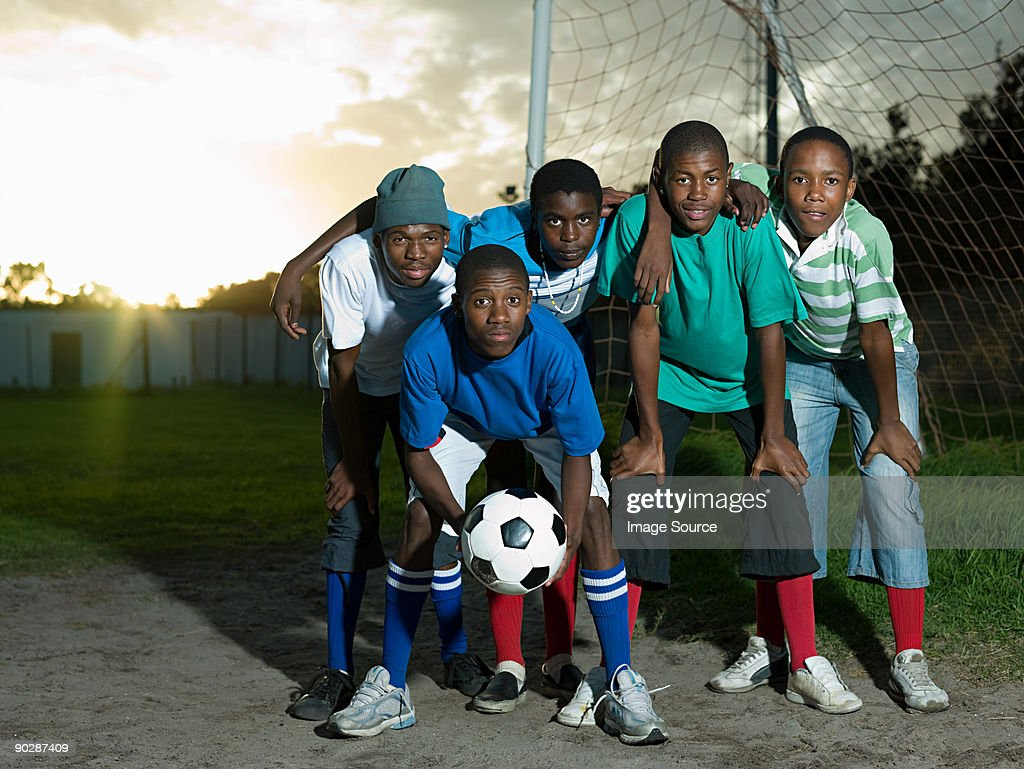 Teenage boys on football pitch : Stock Photo