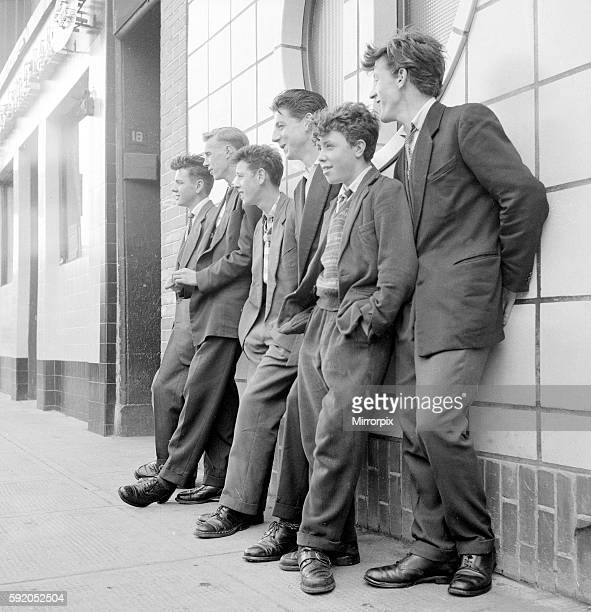 Teenage boys seen here leaning against the wall of the local coffee bar in Govan, Glasgow. September 1956
