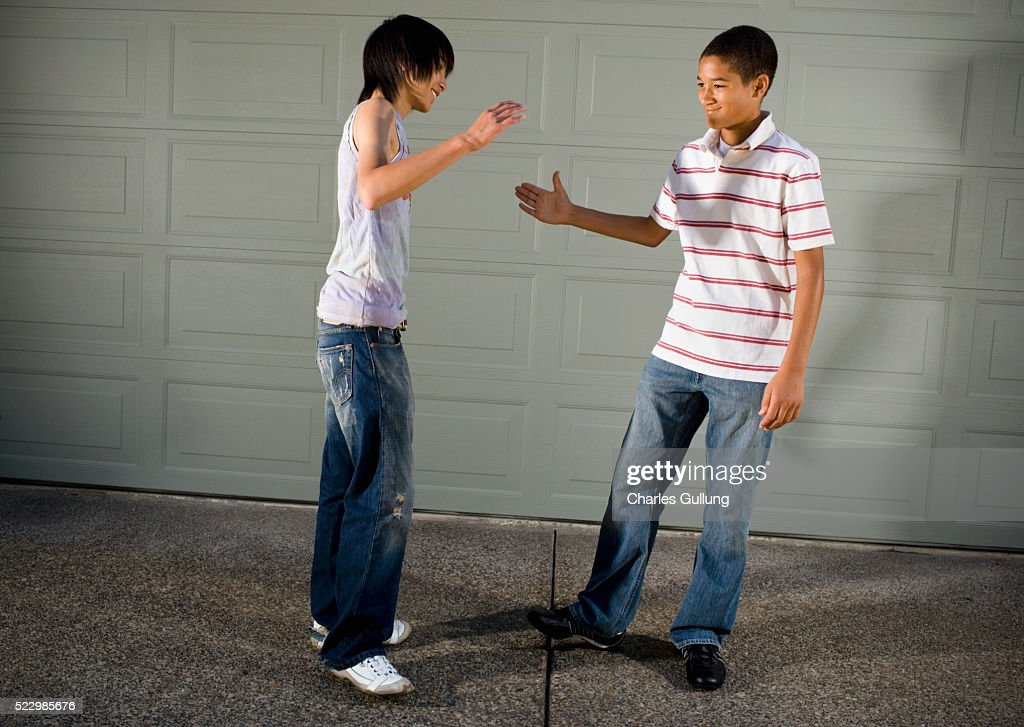 Teenage Boys Shaking Hands Stock Photo - Getty Images