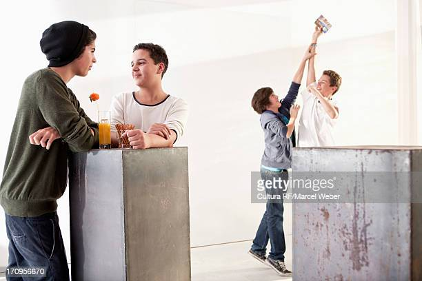 teenage boys socialising - teasing stock pictures, royalty-free photos & images