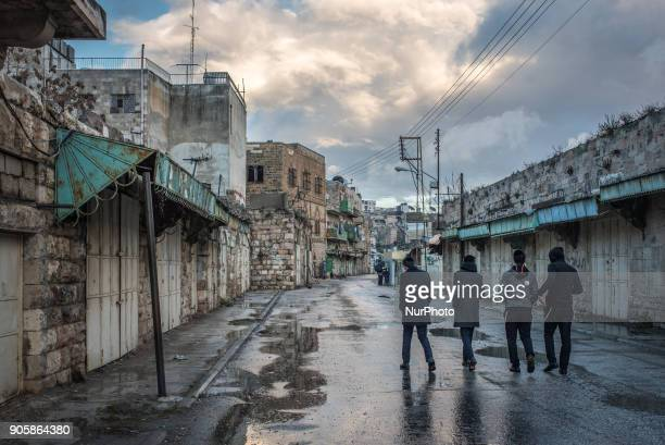 Teenage boys walk past shuttered shops in the military zone of Hebron in the West Bank a Palestinian territory occupied by Israeli forces on 6...