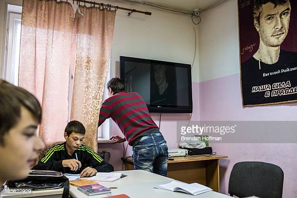 Teenage boys who live at a facility run by City Without Drugs for atrisk youth do their homework underneath a picture of founder Yevgeny Roizman on...