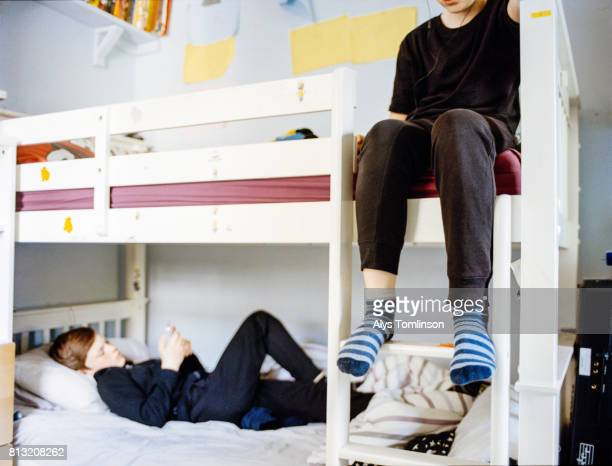 teenage brothers in bunk beds in their bedroom