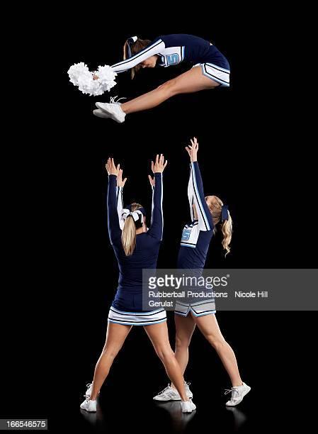 teenage cheerleader girls (16-17) performing - cheerleaders stock pictures, royalty-free photos & images