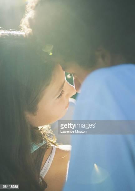 teenage couple about to kiss - human face foto e immagini stock