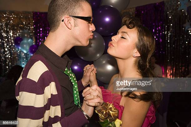 teenage couple almost kissing at prom - indian girl kissing stock photos and pictures